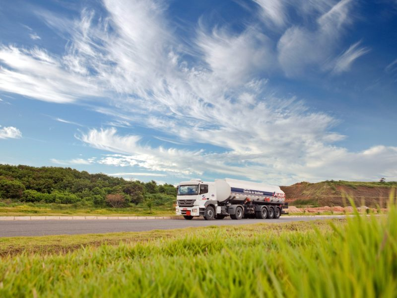 5 truck driving blogs - white fuel truck surrounded by green plants