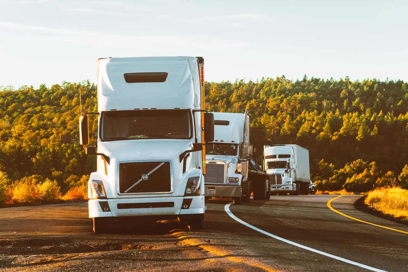 best truck stops in america - three white tractor pulled to the side of the road