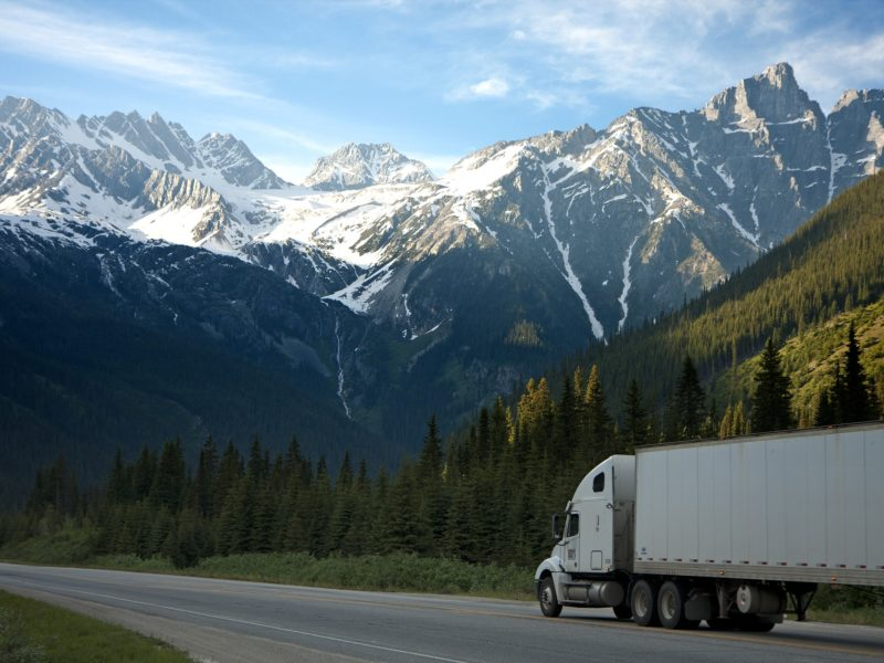 solo truck driver exploring secluded mountain pass