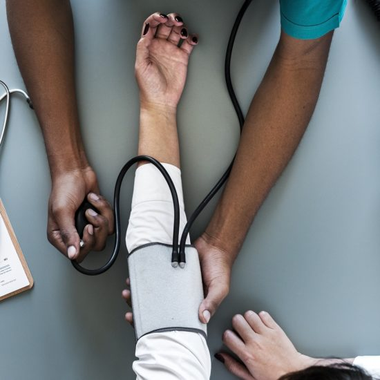 medical conditions disqualify cdl - dr checking blood pressure